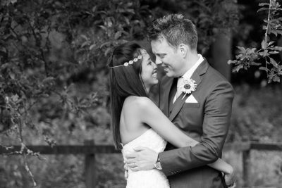 Couple embracing after their wedding at the Crown Inn Pishill Oxfordshire