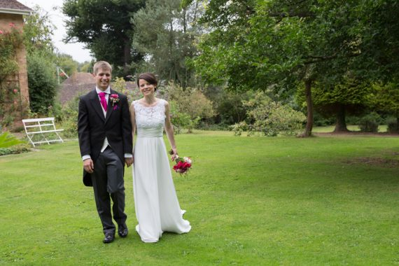 Bride and Groom walking in gardens at Elephant Hotel