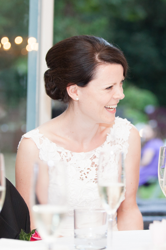 Bride smiling during speeches at Elephant Hotel Berkshire