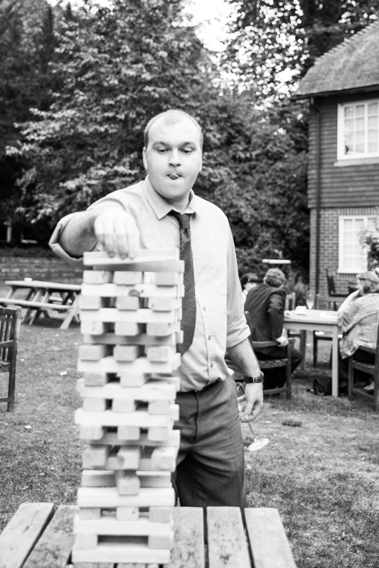 Concentration at game of jenga at Elephant Hotel, Pangbourne