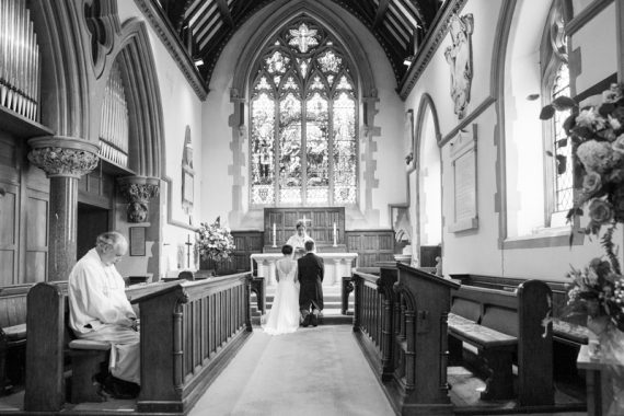 Bride and Groom at the alter of St James Church Pangbourne