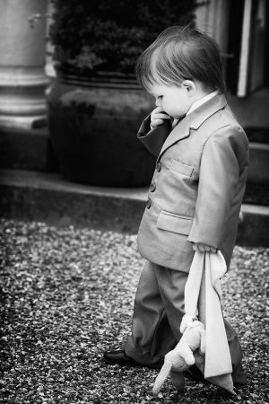Boy attending wedding in Reading. Natural Wedding Photography by Mary Smith