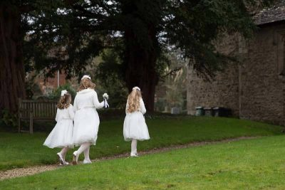 Bridesmaids leaving church documentary wedding photos