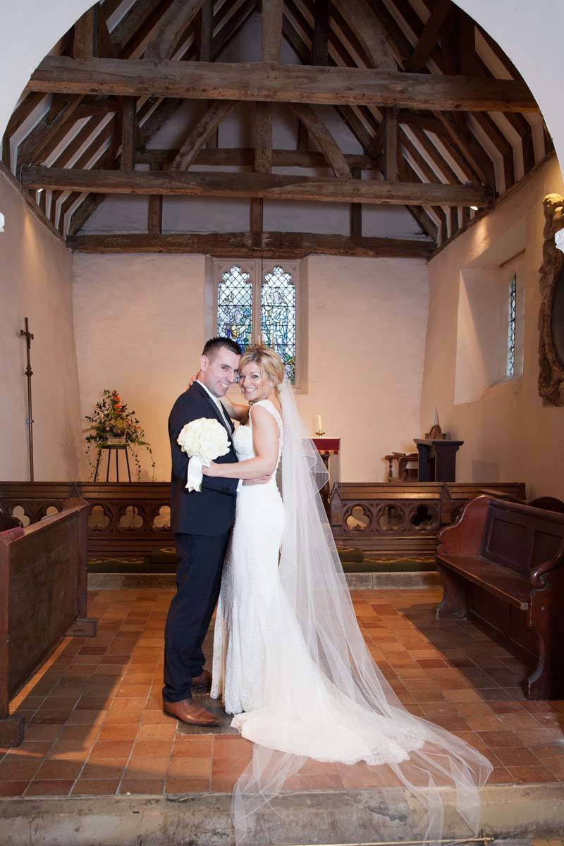 Bride and groom in church natural wedding photography