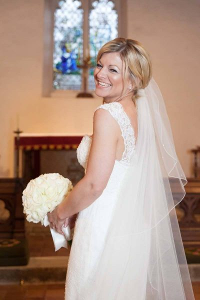 The bride in the church - documentary wedding photography Oxford