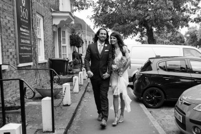 Bride and Groom on their way to their wedding in Beaconsfield Buckinghamshire