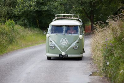 Camper van on its way to a wedding at the Croen Inn Pishill Oxfordshire