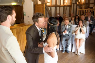 Wedding ceremony kiss at Crown Inn Pishill