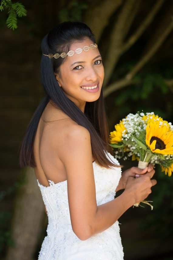 Bride with sunflower bouquet at Crown Inn Pishill