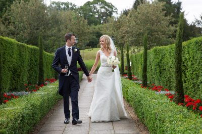 Bride and groom walking together at Danesfield House