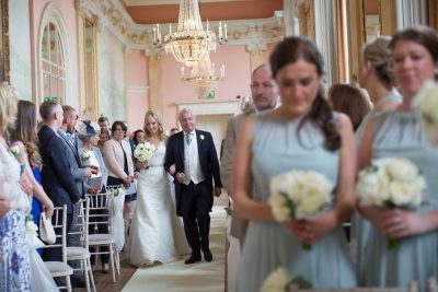 Bride walking down the aisle with her father at Danesfield House