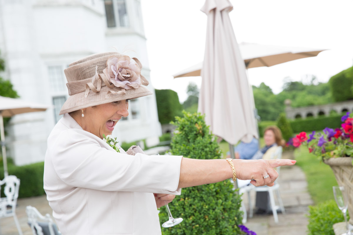 Lady pointing at Danesfield House Wedding