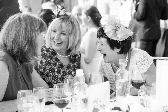 Three ladies laughing together at Danesfield House wedding