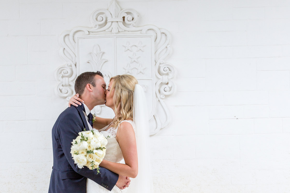 Couple kissing at Danesfield House wedding