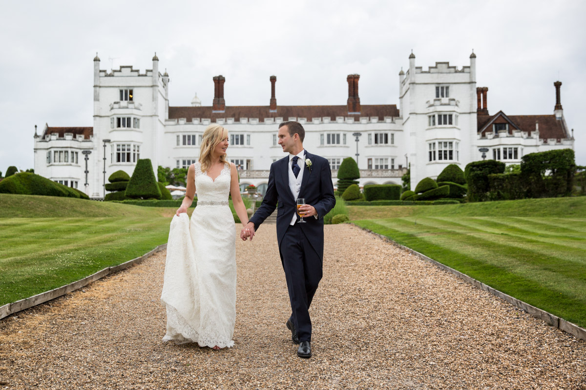 Bride and Groom with Danesfield House in background