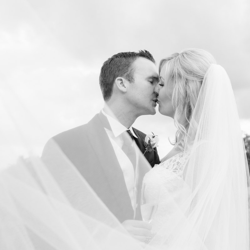 Bride and Groom kissing at their wedding at Danesfield House Buckinghamshire