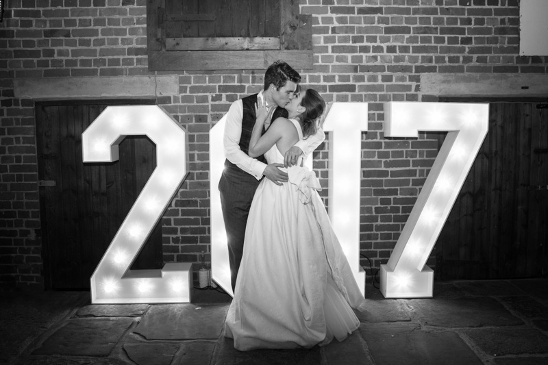 Bride and Groom kissing at their New Year's Eve Wedding at Bix Manor