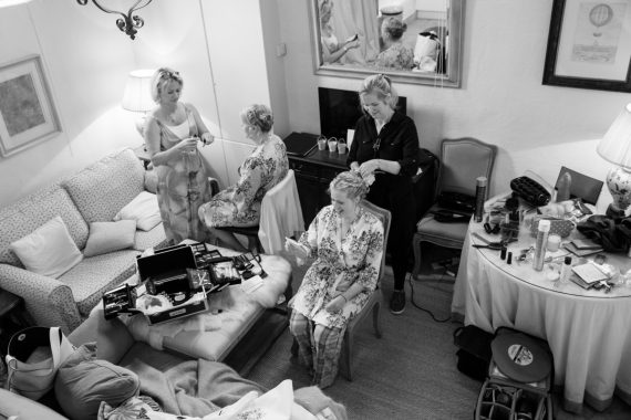 Bride getting ready with bridesmaids at Merriscourt