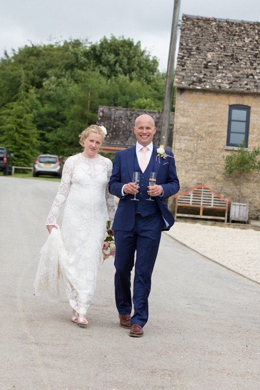 Happy Bride and Groom walking at Merriscourt in Cotswolds