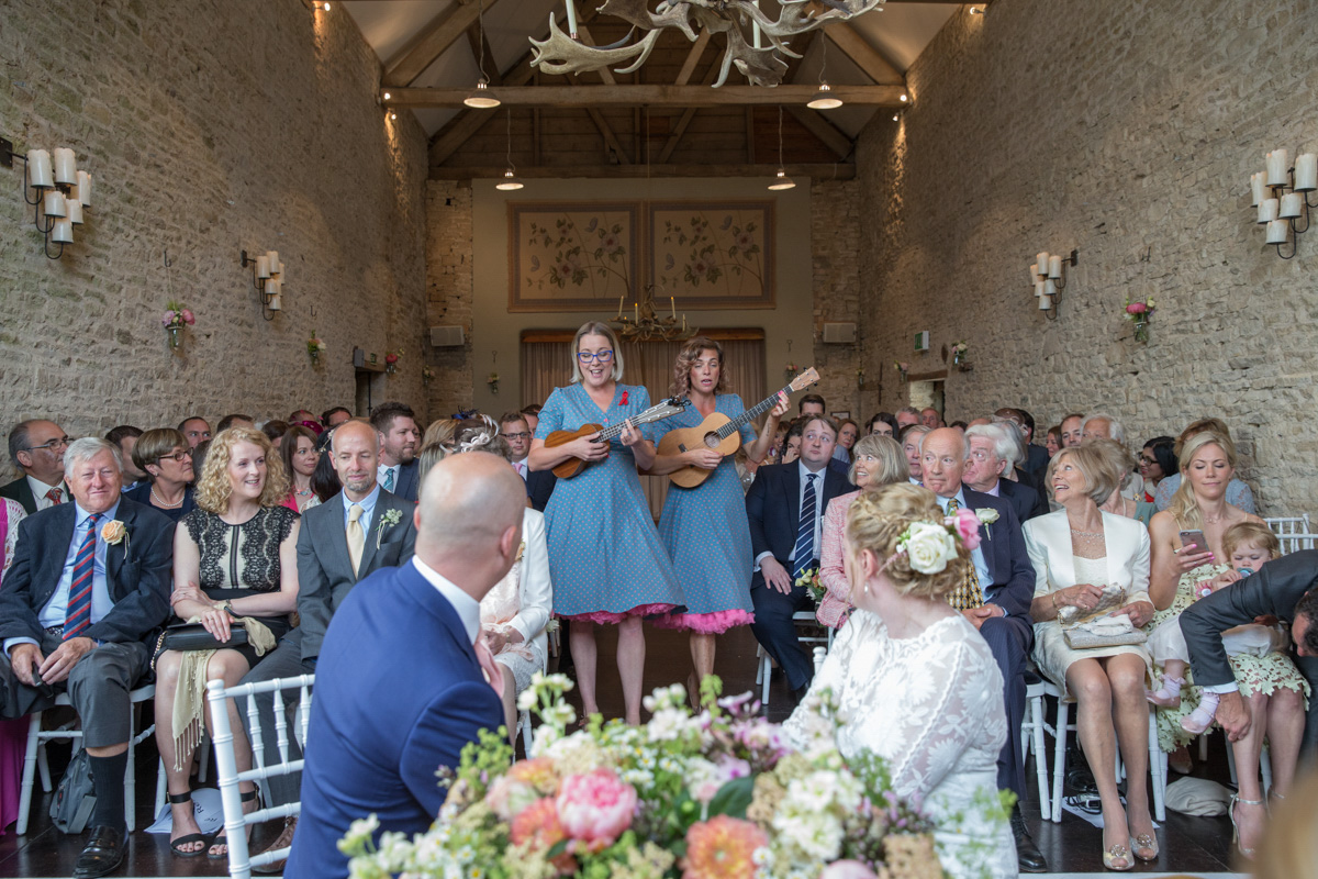 Singers walking down the aisle at Barn Wedding in Cotswolds