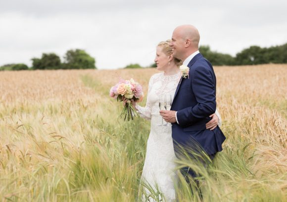 Bride and Groom in field at Merriscourt Barn In Cotswolds