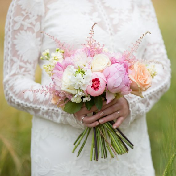 Bride with her bouquet at Merriscourt Barn in Cotswolds