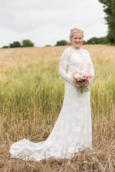 Bridal portrait in field at Merriscourt Barn in Cotswolds