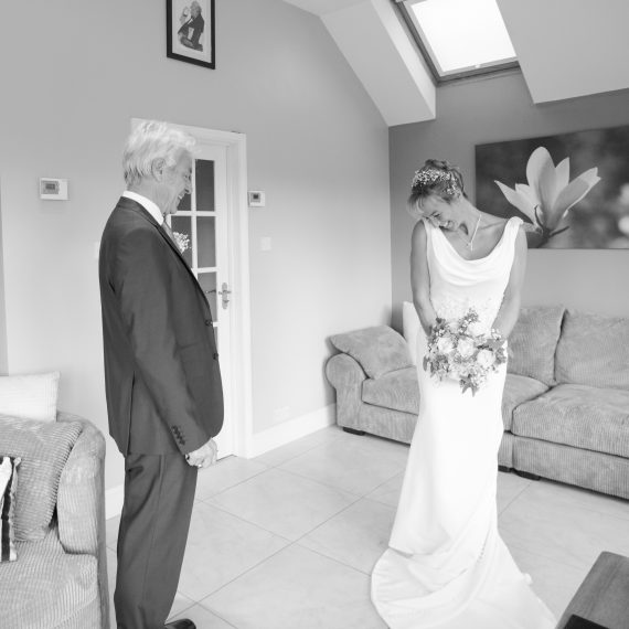 Documentary wedding photography at Bix Manor Oxfordshire. Bride and father