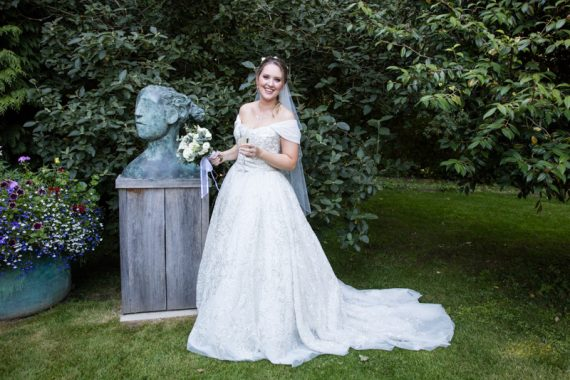Bride in stunning gown in gardens at marque ewedding in Henley Oxfordshire
