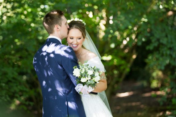 Happy couple at their marquee wedding in Henley Oxfordshire