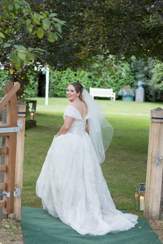 Beautiful bride in garden at her wedding in Oxfordshire