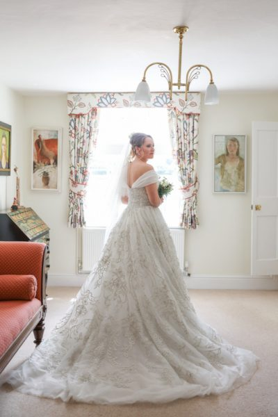Photo of bride in stunning bridal gown at her home in Henley Oxfordshire
