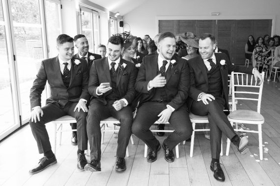 Guys banter at Wasing Park wedding Berkshire
