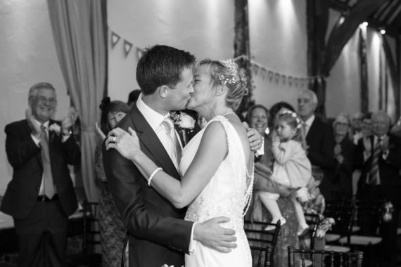 Couple kissing at their Bix Manor Wedding