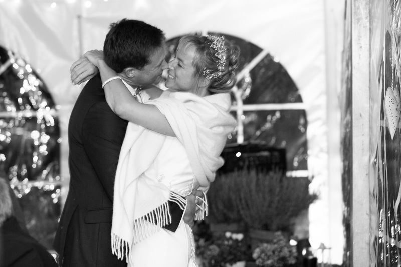 Bride and Groom kissing at Home Sweet Home Roke