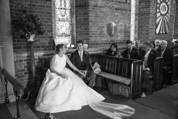 Loving look by Bride and Groom in Bix Manor Church Wedding