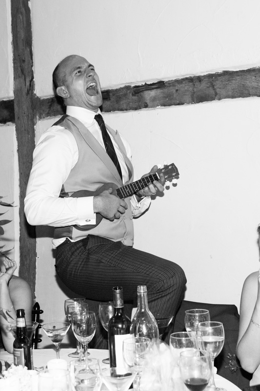 Man playing Ukulele at New Year's Eve Wedding at Bix Manor