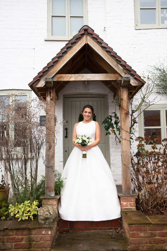 Bride outside her home at Henley Wedding