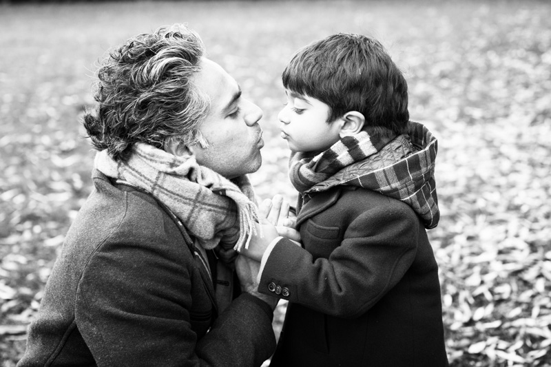 Father and son kissing