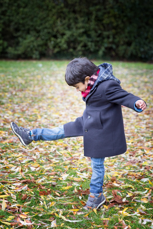 Boy kicking leaves at Henley