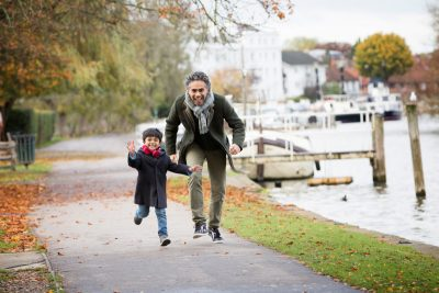 Happy Father and Son at riverside in Henley