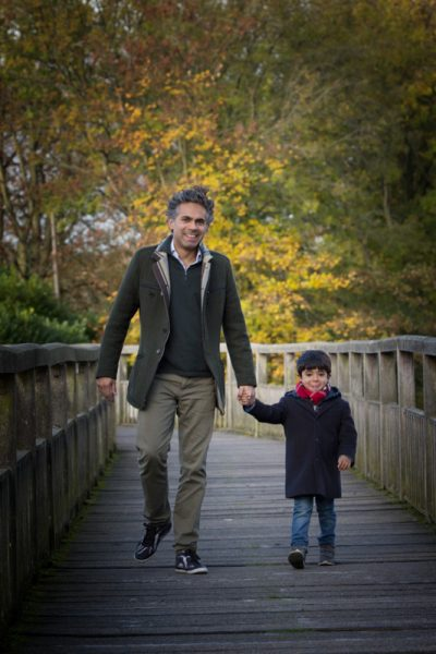 Father and son walking at Henley riverside