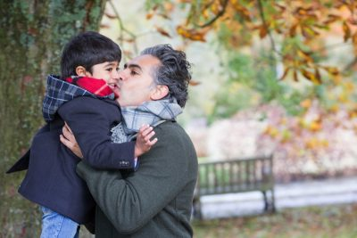 Father kissing son at henley rivers