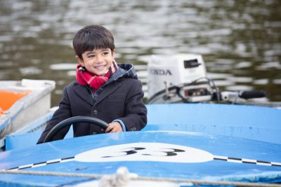 Boy playing on the boats at Henley