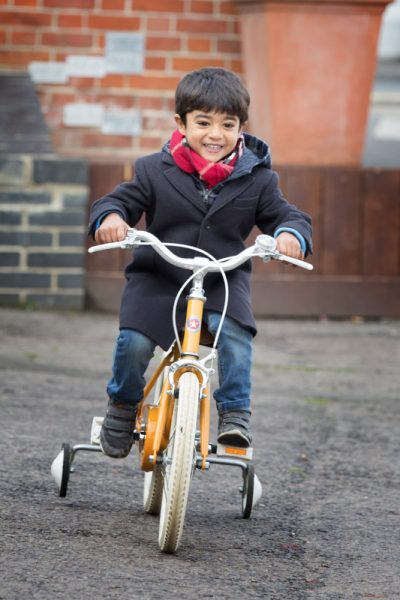 boy playing on his bike Henley
