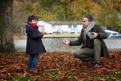 Father and son playing at henley on family photo shoot