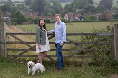 Couple with their dog outside Turville on engagement shoot
