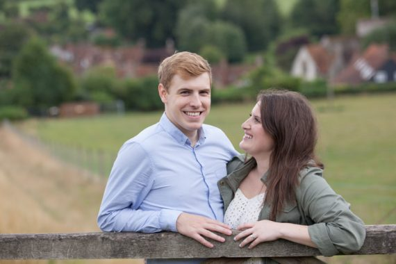 Couple looking at each other on pre wedding shoot in village of Turville