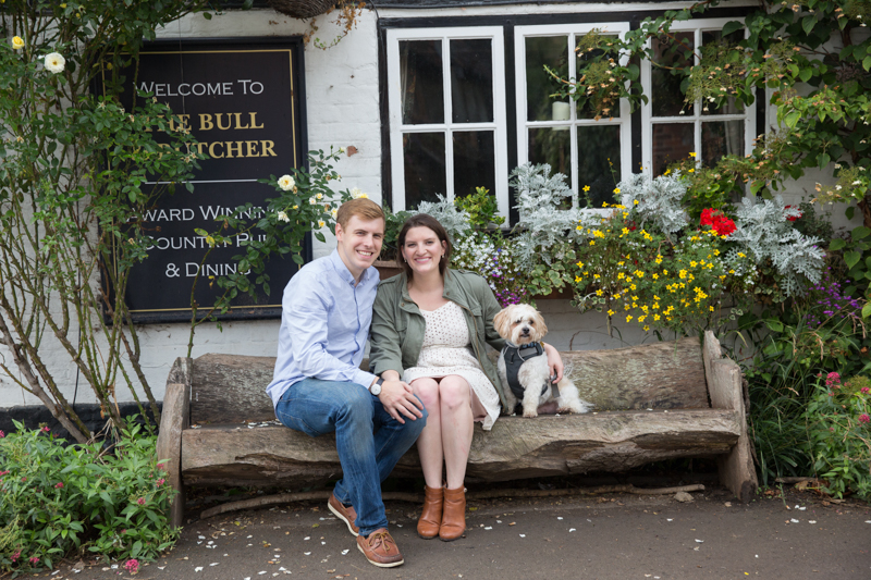 Couple on engagement shoot outside Bull and Butcher pub in Turville