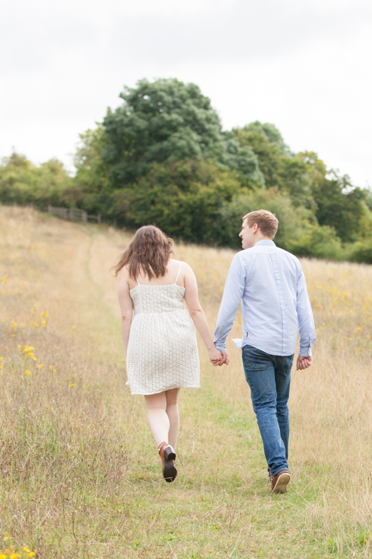 Couple holding hands on their pre wedding shoot near Henley